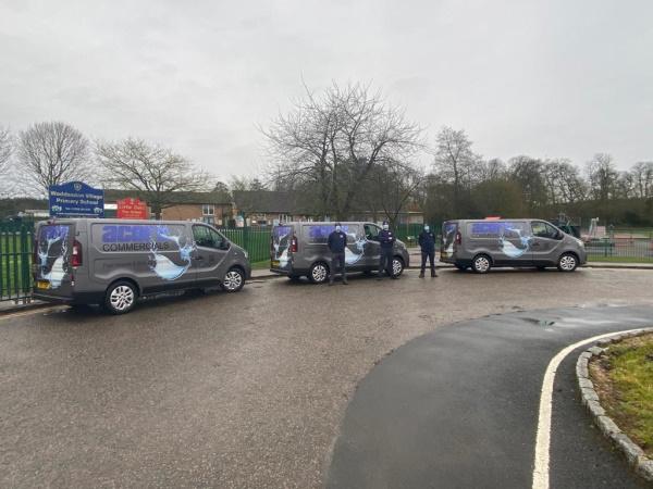 Acorn Commercial vans outside the school gates